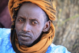 The chief of Deri village. He and the people of his village benefited from CRSÕ assistance in building a water canal near the Niger river which helps them water their produce more effectively.