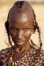 Akadaney, Niger. Old Fulani Woman, with Earrings and Bead Necklaces..