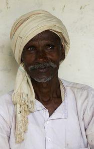 378px-Farmer_adivasi_with_turban,_Umaria_district,_M.P.,_India_-_cropped